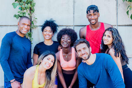 Portrait of a group of runners smiling at camera.