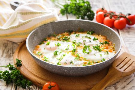 israeli: Shakshuka - traditional dish of israeli cuisine in a skillet Stock Photo