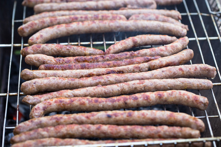 sizzle: Delicious german sausages on the barbecue grill.