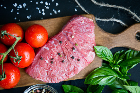seasonings: beef steak with spices and seasonings. a big piece of meat. Stock Photo
