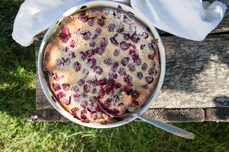 Cherry clafoutis. Homemade cherry pie on rustic background.