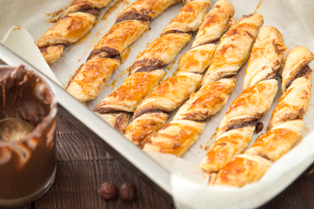 homemade cakes - puff pastry with chocolate paste. twisted cakes with chocolate.