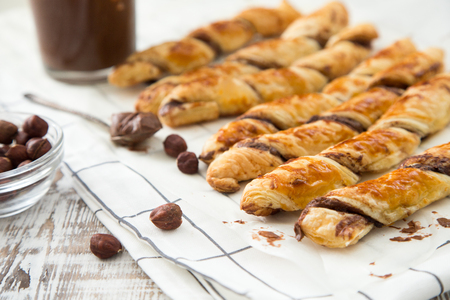 danish: homemade cakes - puff pastry with chocolate paste. twisted cakes with chocolate.