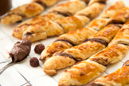 danish puff pastry: homemade cakes - puff pastry with chocolate paste. twisted cakes with chocolate.