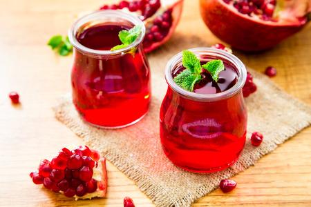 pomegranat: Pomegranate liqueur, Pomegranate juice. old wooden background, selective focus.