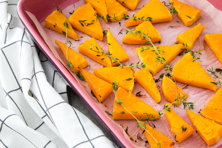 baked pumpkin with thyme in the baking dish.