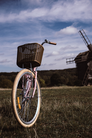 walking bike, a sunny day. mill and field. Stock Photo
