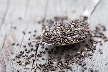 Healthy Chia seeds in a spoon on the table close-up. Nutritious chia seeds Stock Photo