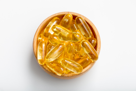 Fish oil capsules with omega 3 and vitamin D. healthy diet concept
