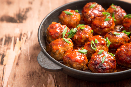 Meatballs in sweet and sour tomato sauce. Homemade roasted beef meatballs in cast-iron skillet. Stok Fotoğraf