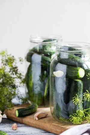 cucumbers, spices and herbs in a preservation jar. Homemade vegetable canning