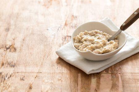 white Bowl of oats porridge. Healthy oatmeal breakfast
