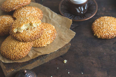 cookies with sesame seeds on wooden background. Healthy snack with sesame /