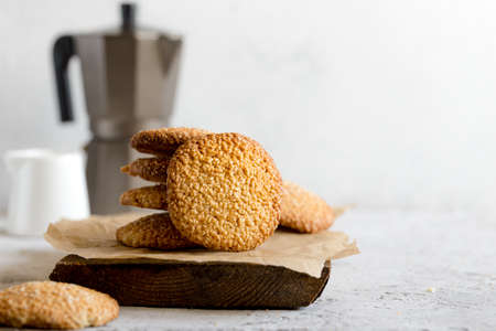 cookies with sesame seeds on gray concrete background. Healthy snack with sesame / Zdjęcie Seryjne