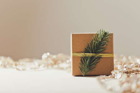 Brown gift box. Christmas present with Christmas tree. copy space Archivio Fotografico