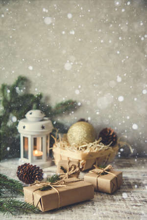 Christmas background. Christmas composition. Christmas gift, pine cones, fir branches on wooden white background Archivio Fotografico