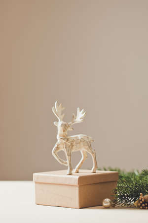 Christmas card conception. Christmas toy deer decoration with christmas tree branch and snow. Archivio Fotografico