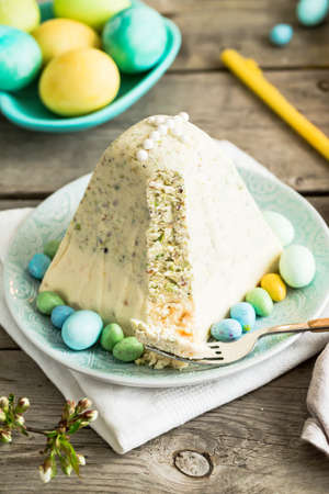 Traditional Easter Ortodox curd cake with pistachios. Traditional Easter cottage cheese dessert. Easter background.