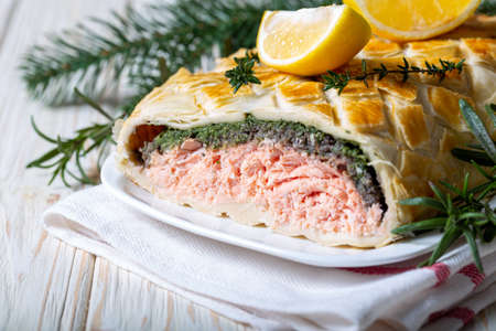 Homemade Salmon Wellington. It is made from Salmon Fish, spinach, mushrooms, spices, herbs and puff pastry. Copy space