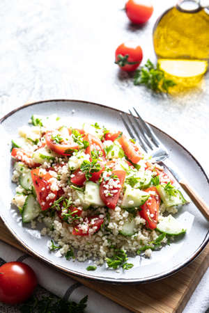 Traditional oriental salad Tabouleh. Tabule cous cous salad with vegetables. Tabbouleh with bulgur Archivio Fotografico