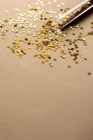 Golden sparkles stars on gold holiday background. Festive backdrop for your projects