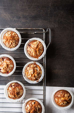 homemade muffins on a baking rack on a wooden background. place for your text, flat lay background. place for your text, flat lay
