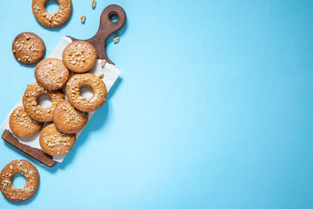 homemade shortbread cookies with peanuts on a trendy blue background. peanut cookie. flat lay, place for text, food background. Archivio Fotografico