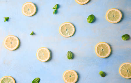 background with ingredients for lemonade or mojito cocktail. creative concept flat lay.