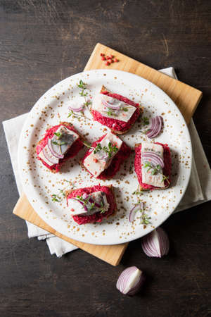 herring appetizer. Herring with beets on rye bread. Brain food concept. Home cooking. Archivio Fotografico