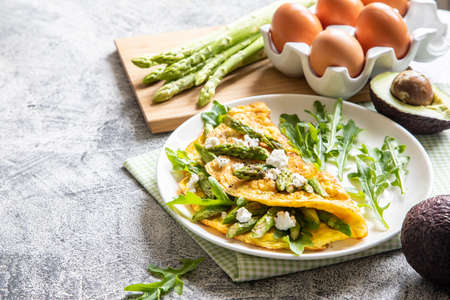 Gourmet Tasty Egg Omelette with Asparagus and soft Cheese. Asparagus. Fresh Asparagus with eggs.