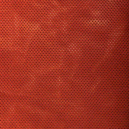 Texture of perforated brown leather