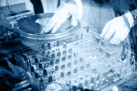 turntables: Deejays hands and turntables. Photo from nightclub. Stock Photo