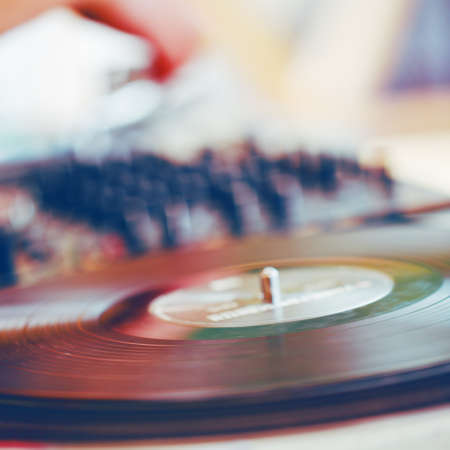 Music background - blurred turntable and mixer