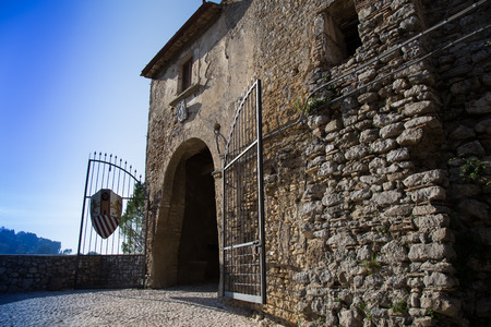 back gate: Of the old village entry arc with gate Editorial