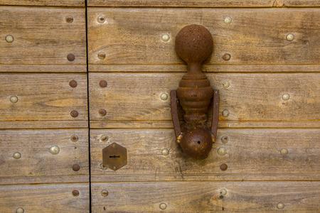 doorknocker: Knocker to knock on an old wooden door
