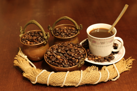 expressed: Coffee beans or seeds in copper bowls with jute