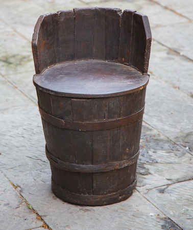 Wine barrel cut in half to make a Chair