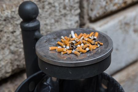 Ashtray full of cigarette butts Stock Photo