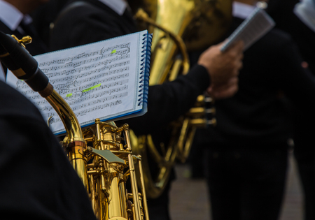 octaves: Orchestral band musician reading the sheet music