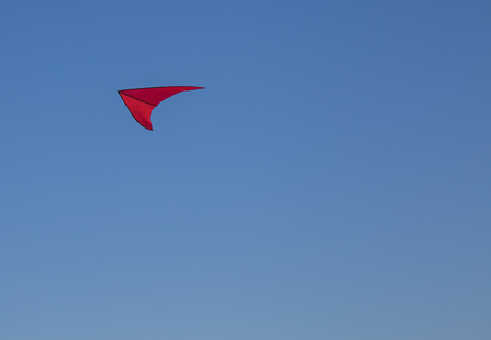 Kite colored with little wind in a spring day Stock Photo