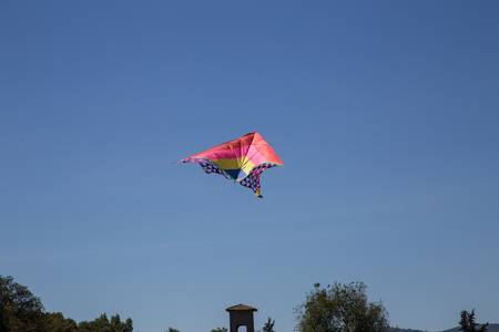 aerodynamic: Kite hit from the Sun on a background of blue sky Stock Photo
