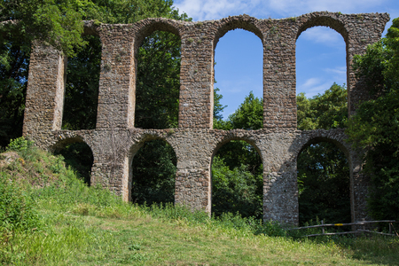Ruins of the aqueduct in the lost city of Monterano Stock Photo