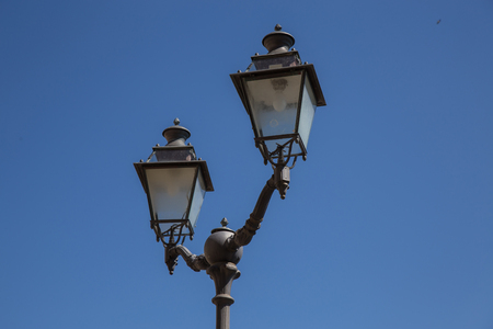 lighted: Lamp post with two lanterns in the old style