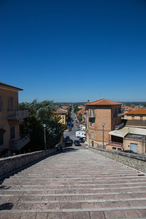 street lamp: Staircase in Castiglione del Lago with a view of a long straight Editorial