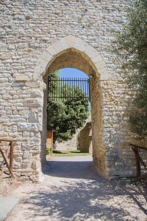 archaeological: Stone arch entrance to the fortress in Castiglione del Lago