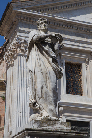mediterranean culture: Statue on the façade of the Cathedral of Urbino Stock Photo
