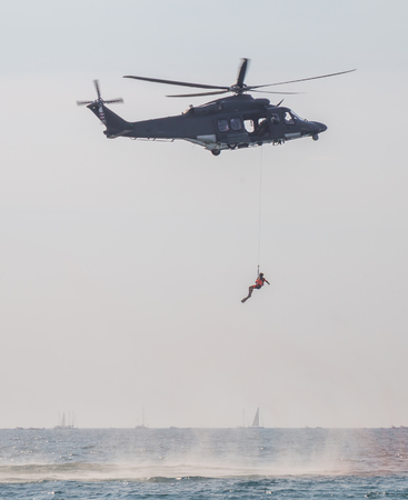 Rescue helicopter and sent a rescuer in water Editorial