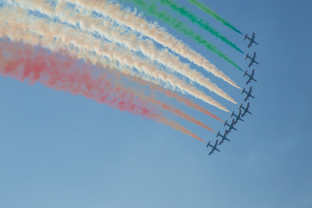 Air show with colored smoke in white green and red