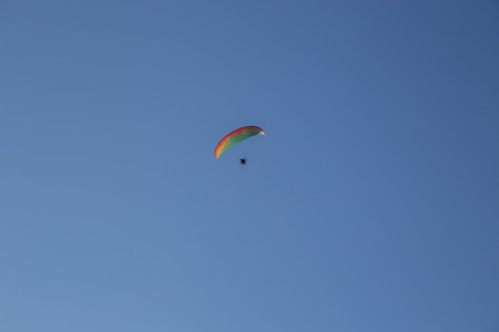Paramotor flying during a performance Stock Photo