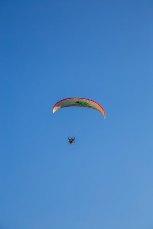 Paramotor flying during a performance Editorial